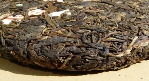 http://www.jas-etea.com/2000-yong-pin-hao-yi-wu-zheng-shan-stone-pressed-raw-tea-380g/