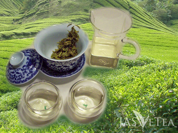 A tasty bit of Bi Luo Chun enjoyed against a background of brilliant green tea bushes stretching over the hills.